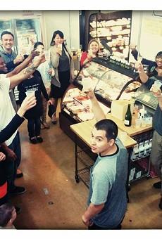 The staff celebrates the announcement of The Texas Cheese Cellar.