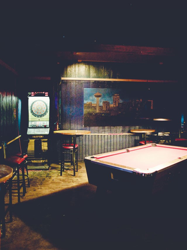 The windowless Cobalt Club is dark even at 7 a.m. — if only this pool table could talk... - JOSH HUSKIN