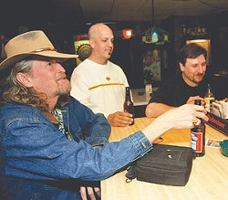 Thomas Satchell, Joe Cordani, and Chris K. Gwin knock back some brews at Recovery Room.
