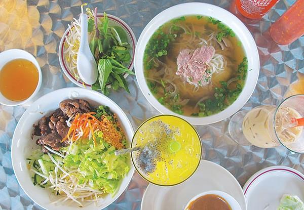 Top row L-R: fish sauce, garnish plate, No. 31 flank steak pho tál; - Bottom row: bun thit nuong chá gio, orange honey ginger tea - JUSTIN PARR