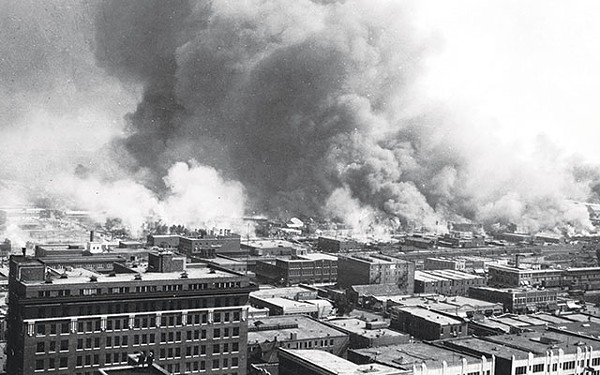 "Tulsa's ""Black Wall Street"" in flames during a white-on-black riot - COURTESY PHOTO"