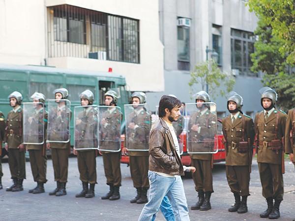 TV ad man René Saavedra (Gael García Bernal) walking past Chile's finest in 1988. - COURTESY PHOTO