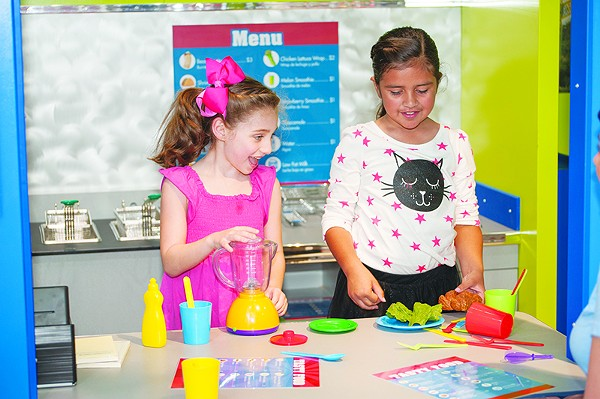 Young chefs in the making can tinker with new recipes in The DoSeum's interactive Tiny Town exhibit. - COURTESY
