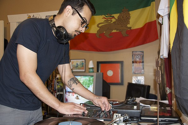 Josh Lucio of Four Hands spinning dub at home. - MATT STIEB