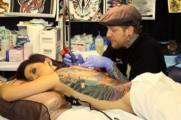 Jedidiah Reid working at a past Alamo City Tattoo Show. - JOHN BONILLA
