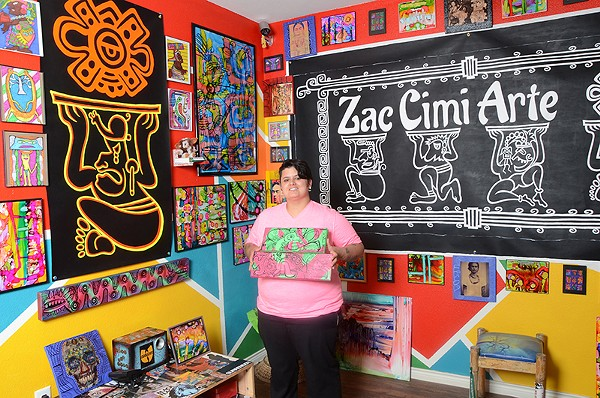 Nina Donley surrounded by her artwork at her West Side gallery, Zac Cimi Arte. - BRYAN RINDFUSS