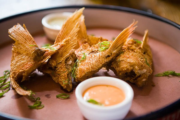 Start digging — rich and meaty treasures are found inside the fried snapper throats. - DAN PAYTON