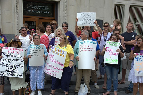SA members of the Service Employees International Union rallied last week in front of city hall. - MICHAEL MARKS