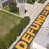 Laredo Residents Complete 'Defund the Wall' Street Mural in Front of Federal Courthouse