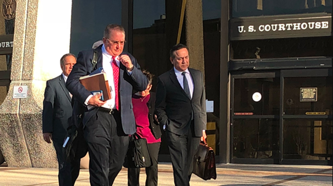 Attorney Michael McCrum and Carlos Uresti exit U.S. federal courthouse. - ALEX ZIELINSKI