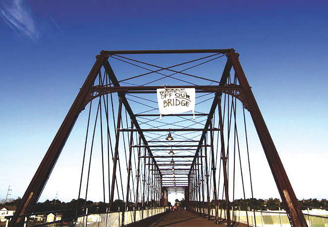 Activists hung a banner from the bridge in 2012 to protest the construction of the Alamo brewery. - MICHAEL BARAJAS