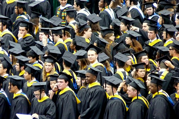 Look at all these poor saps getting ready to work their asses off to pay down their college debt. - WIKIPEDIA COMMONS
