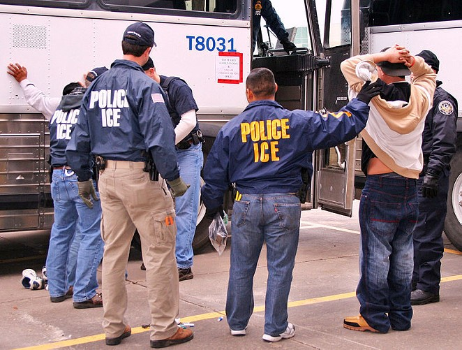 ICE agents arrest a suspect during a raid. - WIKIPEDIA COMMONS
