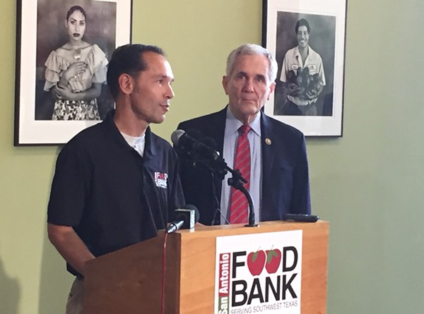 The S.A. Food Bank's Eric Cooper (left) and Rep. Lloyd Doggett discuss the farm bill's proposed cuts to food assistance. - PHOTO BY SANFORD NOWLIN