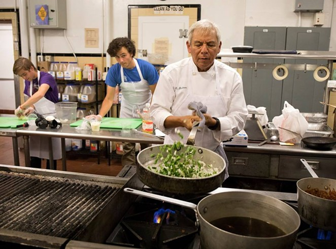 Adán Medrano cooks up some nopales in the kitchen. - VIA ADÁN MEDRANO
