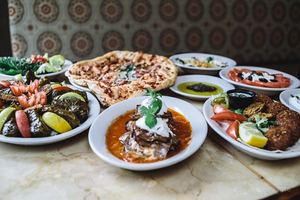 A spread of Pasha's appetizers, including dolmas, naan, falafel and kashke bademjan, an eggplant dip. - COURTESY OF PASHA