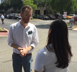 Luke Metzger meets with Whataburger's Karina Alderete in front of the burger chain's corporate office. - SANFORD NOWLIN