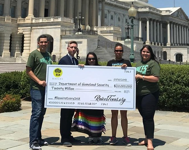 RAICES officials show their $20 million check in front of the Capitol Building in Washington D.C. - VIA RAICES'S FACEBOOK PAGE
