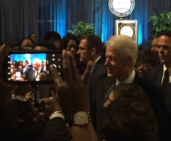 President Bill Clinton makes his entrance at the NAACP's gala. - SANFORD NOWLIN