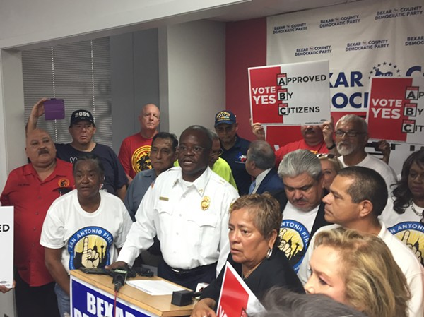 Chris Steele speaks at the Bexar County Democratic Party headquarters. That's not a real firefighters shirt he's wearing. - SANFORD NOWLIN