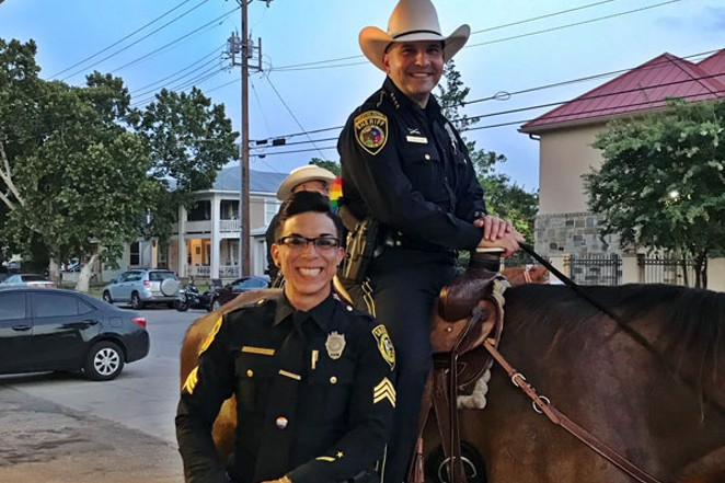 Bexar County Sheriff Javier Salazar with Sgt. Stephanie Flores at this year's Pride Parade. - COURTESY