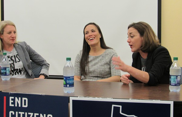 Lucinda Guinn (left) and Gina Ortiz Jones (center) listen to Tiffany Muller make a point during Friday's panel discussion. - SANFORD NOWLIN