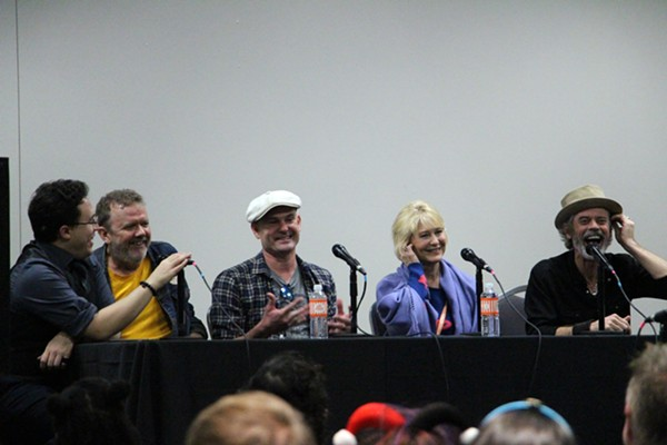Moderator Moisés Chiullán and the E.T. cast share a laugh during Saturday's panel - KELLY MERKA NELSON