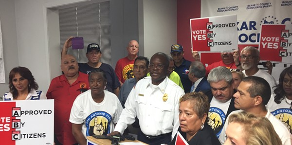 Fire union officials speak at a press conference during the runup to the charter amendment vote. - SANFORD NOWLIN