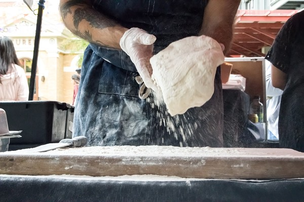 Grimes adds flour to the dough before it has been proofed. - LEA THOMPSON