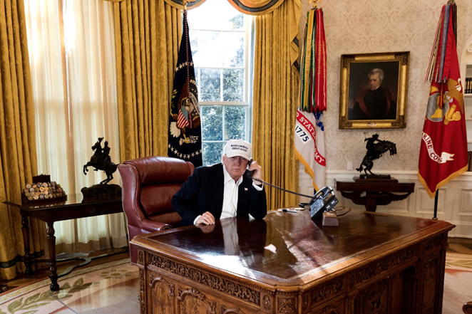 """Donald Trump is shown """"working"""" as hard as a furloughed employee in this White House publicity photo. - COURTESY OF THE WHITE HOUSE"""