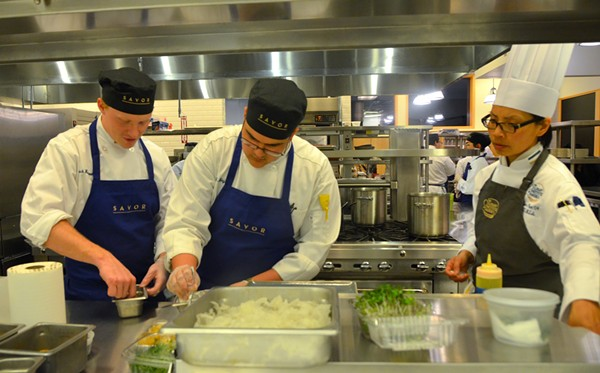 CIA students prepare dishes for guests at Savor. The restaurant will provide students with real world experience before they graduate. - LEA THOMPSON