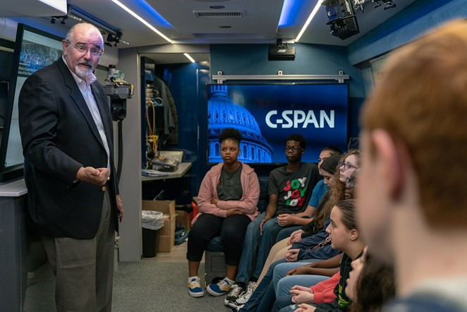 A Harris County precinct commissioner visits with students on the C-Span bus. - TWITTER / CSPANBUS