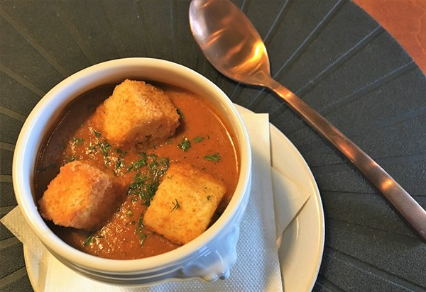 Roasted tomato soup, served with house-made croutons, is among Spoon's familiar but well-executed dishes. - RON BECHTOL