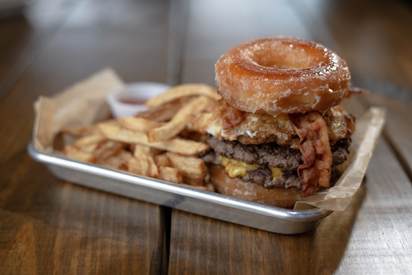 The Krispy Kreme Brunch Burger from Lucy Cooper's Ice House - ERIK GUSTAFSON