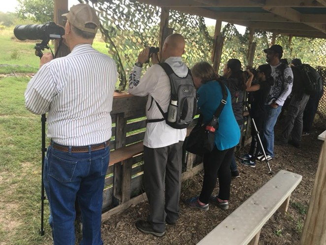 Bird-watchers engage in their hobby at the National Butterfly Center, one of the parks threatened by a planned section of the border wall. - FACEBOOK / NATIONAL BUTTERFLY CENTER