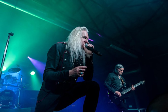 Saxon singer Biff Byford leans on the monitor while guitarist Paul Quinn unleashes a monster riff. - JAIME MONZON