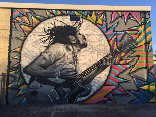 Mural of Nic Long of Lonely Horse off the N. St. Mary's Stip - FACEBOOK / LONELY HORSE