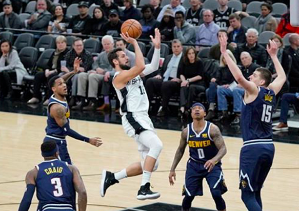 Spur Marco Belinelli drives through the Denver defense. - INSTAGRAM / SPURS