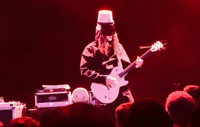 Enigmatic guitar shredder Buckethead shows off his technique from the Aztec stage. - MIKE MCMAHAN