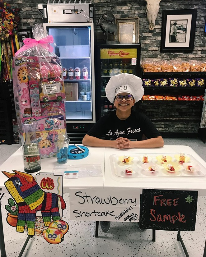 Sarita Hernandez, the youngest member of the Hernandez family, invites customers to enter the business' Easter raffle. - COURTESY