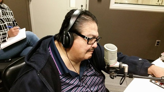 The late Jimmy Gonzalez takes the mic during an appearance on KXTN radio. - VIA GRUPO MAZZ'S FACEBOOK PAGE