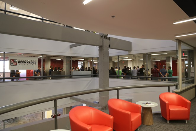 Employees meet inside Rackspace's corporate headquarters. - COURTESY