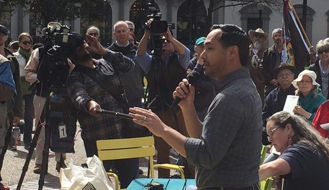 Joaquin Castro speaks to a crowd at a recent immigration rally in San Antonio. - SANFORD NOWLIN