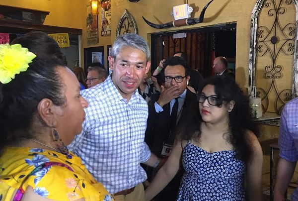 Ron Nirenberg meets with supporters during his Saturday night election watch party. - SANFORD NOWLIN