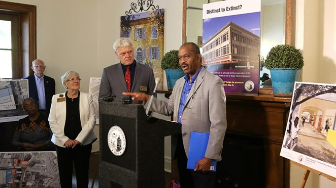 San Antonio Conservation Society President Susan W. Beavin (from left); Vincent L. Michael, executive director of the San Antonio Conservation Society; and local architect Everett Fly speak at a press conference at the Dashiell House at La Villita on Tuesday. - BEN OLIVO