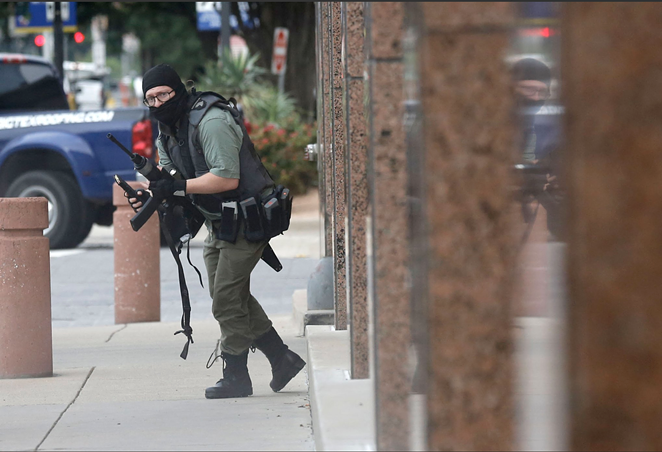 An image of the gunman captured by Tom Fox, who was at the courthouse to cover another story. - DALLAS MORNING NEWS / TOM FOX VIA TWITTER