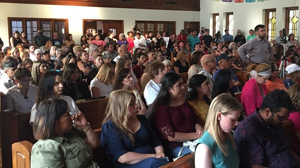 People at a San Antonio town hall on domestic violence listen to a survivor share  her story. - SANFORD NOWLIN