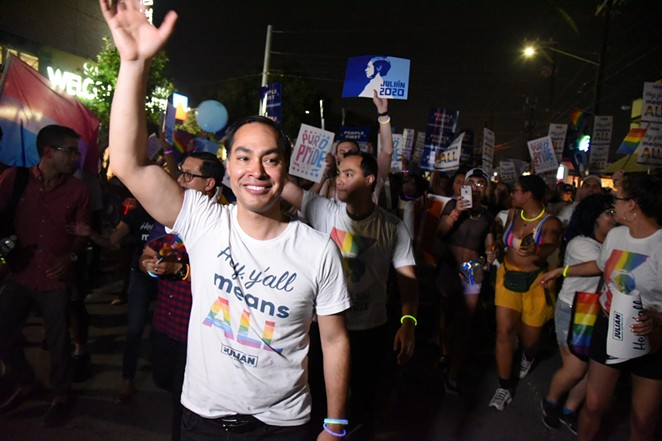 Julian Castro waves to the crowd during the Pride Bigger Than Texas Parade. - JULIAN LEDEZMA