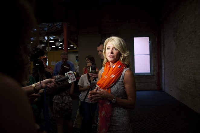 Wendy Davis speaks with reporters at a #StandWithTXWomen rally. - JENELLE ESPARZA