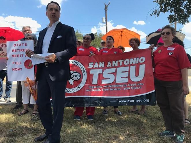 State Sen. Jose Menendez speaks at the Texas State Employees Union rally in San Antonio. - SOL WEINER